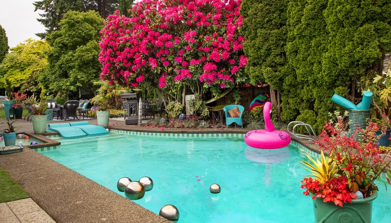 """Sharalyn Ferrel loves the stainless steel orbs that dance in her pool, because they are so reflective. The balls create a distinctive """"clink"""" as they swirl around. (Mike Siegel / The Seattle Times)"""