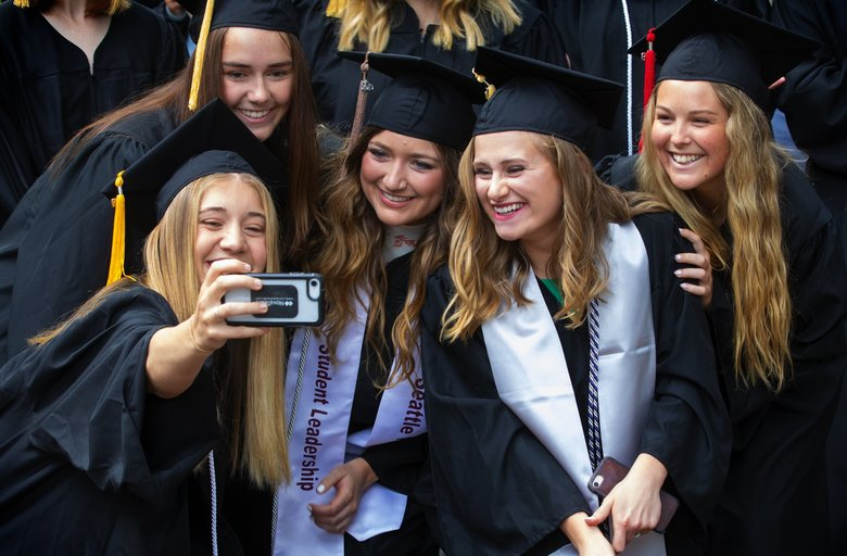 Nikki Harasta takes a selfie with her roommates as they all graduate from Seattle Pacific University's at SPU's Ivy Cutting 2019 ceremony Friday. (Ellen M. Banner / The Seattle Times)