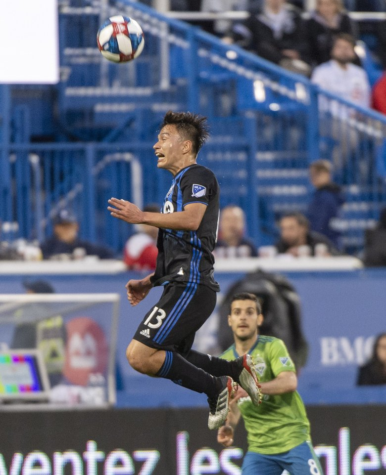 Montreal Impact midfielder Ken Krolicki heads the ball away from Seattle Sounders midfielder Victor Rodriguez during the first half of an MLS soccer match Wednesday, June 5, 2019, in Montreal. (Paul Chiasson / The Associated Press)