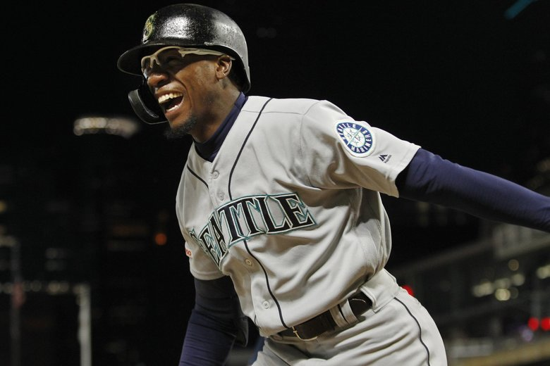 Seattle Mariners' Shed Long celebrates his three-run home run against the Minnesota Twins during the eighth inning of a baseball game Wednesday, June 12, 2019, in Minneapolis. (Bruce Kluckhohn / The Associated Press)