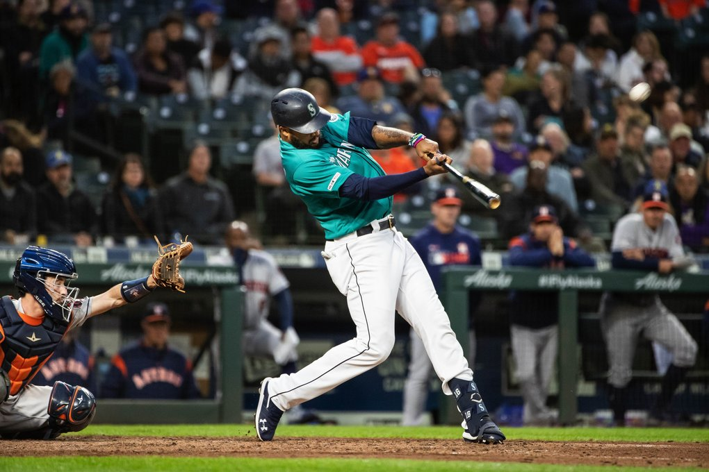 Domingo Santana launches a 2-run homer in the 6th that gives Seattle a 4-1 lead over the Astros. (Dean Rutz / The Seattle Times)