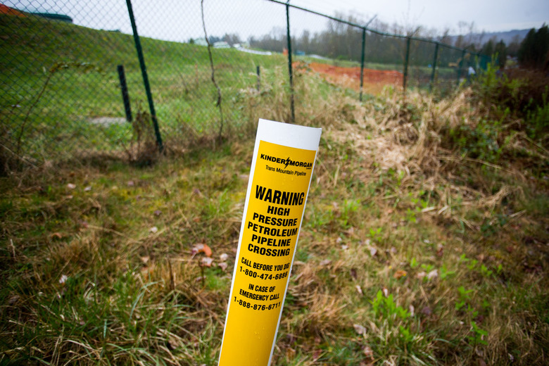 A petroleum pipeline crossing marker stands near the Kinder Morgan facility in Burnaby, British Columbia, Canada, on April 11, 2018. (Bloomberg photo by Ben Nelms).