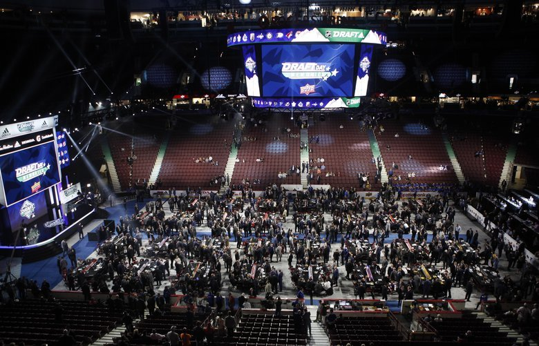 Teams, owners, coaches and other personnel get ready for the start of the second round of the NHL draft at Rogers Arena in Vancouver, British Columbia, Saturday, June 22, 2019. (Chad Hipolito/The Canadian Press via AP) CAH100 CAH100