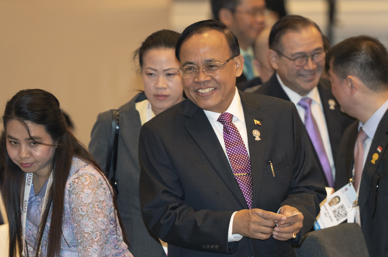 Myanmar Minister of State for Foreign Affaires Kyaw Tin, center, prepares ahead of the Association of Southeast Asian Nations (ASEAN) Foreign Ministers' meeting in Bangkok, Thailand, Saturday, June 22, 2019. (AP Photo/Gemunu Amarasinghe)