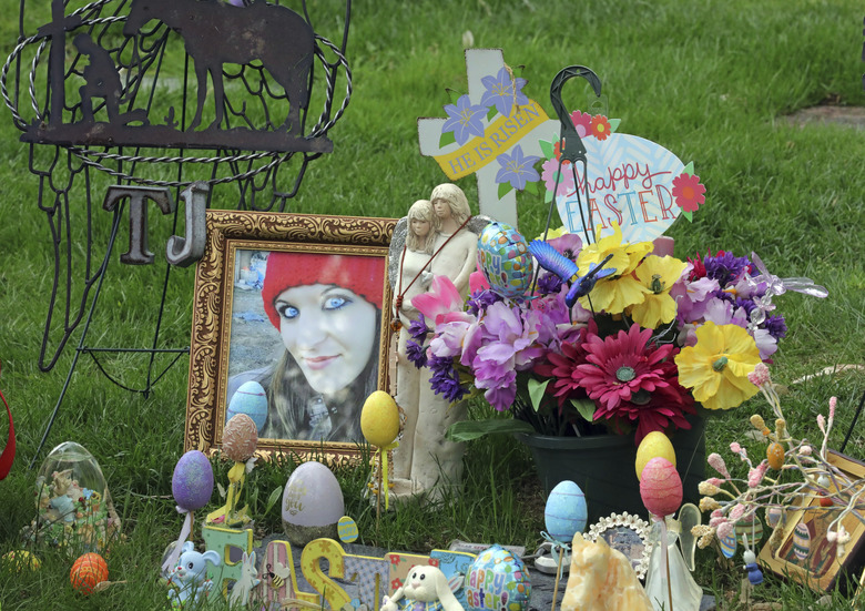 An arrangement of photos, flowers and Easter eggs surrounds the grave of Tanna Jo Fillmore on Friday, April 26, 2019, in Salt Lake City. Fillmore, who had a history of mental problems, killed herself in Duchesne County jail in 2016 while locked up on a probation violation. She told her mother she was being denied her prescription medicines that had stabilized her. (AP Photo/Rick Bowmer)