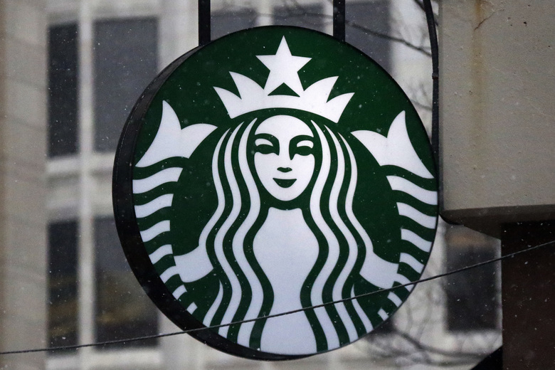 "FILE – This March 14, 2017 file photo shows the Starbucks logo on a shop in downtown Pittsburgh. Starbucks and environmental charity Hubbub announced Monday, June 10, 2019 are launching a trial program to lend passengers at Britain's Gatwick Airport reusable cups while waiting for their flights in hopes of cutting down on waste. The one-month pilot program will give passengers at Britain's second-largest airport the option of borrowing the cup _ rather than using a paper one _ and disposing of it before getting on their flights at ""Cup Check-In'' points. (AP Photo/Gene J. Puskar, File)"