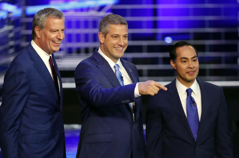 Democratic presidential candidates New York City Mayor Bill de Blasio, Rep. Tim Ryan, D-Ohio, and former Housing and Urban Development Secretary Julian Castro stand on the stage before a Democratic primary debate hosted by NBC News at the Adrienne Arsht Center for the Performing Art, Wednesday, June 26, 2019, in Miami. (AP Photo/Wilfredo Lee)