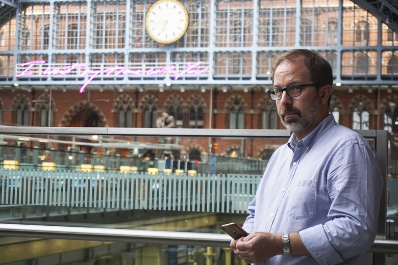 Russia expert Keir Giles poses for a portrait during an interview at London's St. Pancras Station on Tuesday, June 4, 2019. Giles, who is affiliated with Britain's Chatham House think tank, was one of the people who was targeted by a LinkedIn user calling herself Katie Jones earlier this year. (AP Photo/Raphael Satter)