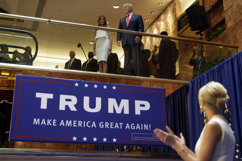 FILE – In this Sunday, June 16, 2015, file photo, Donald Trump, accompanied by his wife Melania Trump, is applauded by his daughter Ivanka Trump, right as he's introduced before his announcement that he will run for president in the lobby of Trump Tower in New York. It was the escalator ride that would change history. Four years ago on Sunday, Donald Trump descended through the marble and brass atrium of Trump Tower to announce his candidacy for president. It was the first step on a journey few believed would take him all the way to the White House. (AP Photo/Richard Drew, File)