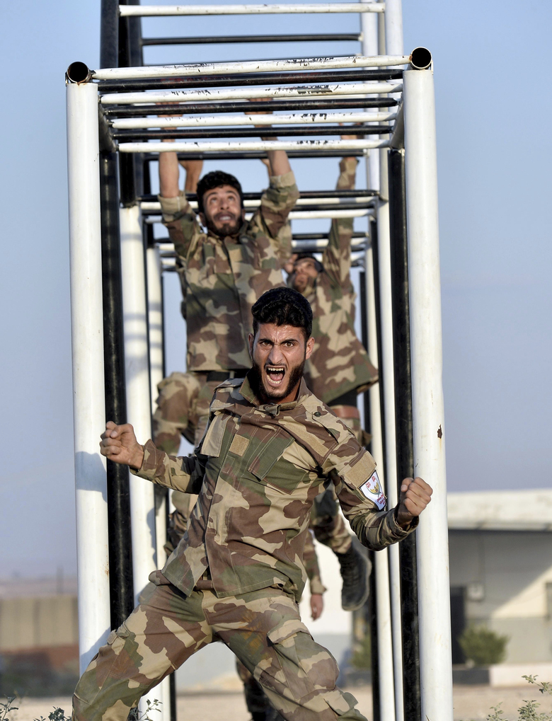 FILE – In this Sept. 11, 2018, file photo, Turkey-trained Syrian opposition fighters of the National Army group, formally known as Free Syrian Army, train in a camp in the Turkish-controlled northwestern city of Azaz, Syria. The violence raging once again in the northwestern province of Idlib, Syria's last rebel-held bastion, is putting Turkish-Russian relations to the test. (Ugur Can/DHA via AP, File)