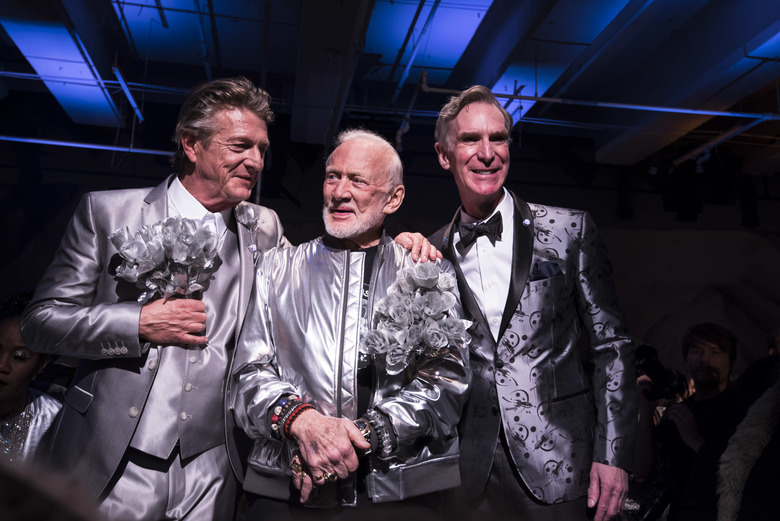 """Fashion designer Nick Graham, left, with former astronaut Buzz Aldrin, center, and science educator and television personality Bill Nye pose at the conclusion of Graham's """"Mission to Mars"""" show in January 2017. (Karsten Moran/The New York Times)"""
