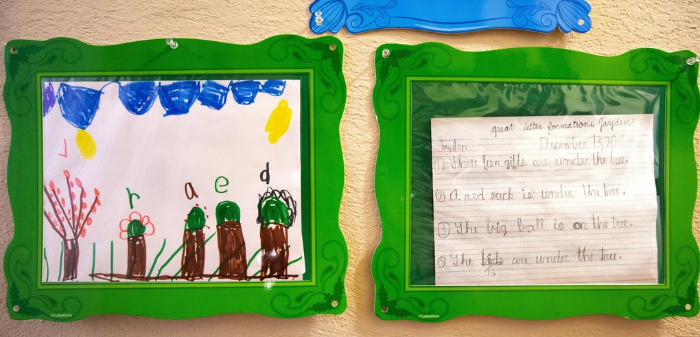 Samples of Jayden Phillips' work show how much he improved his writing between kindergarten and fourth grade. (Mike Siegel / The Seattle Times)
