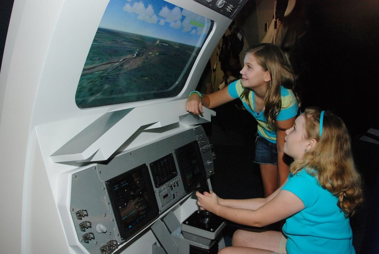 Children operate a landing simulator at the Kennedy Space Center. (courtesy of Kennedy Space Center Visitor Complex)