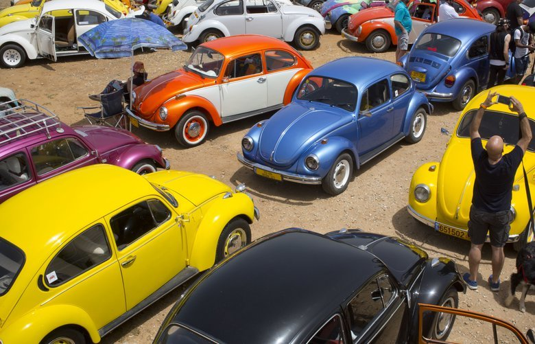"""FILE – In this April 21, 2017 file photo, Volkswagen Beetles are displayed during the annual gathering of the """"Beetle club"""" in Yakum, central Israel. The Israeli Beetle club was founded in 2001 and there are 500 members. Volkswagen is halting production of the last version of its Beetle model in July 2019 at its plant in Puebla, Mexico, the end of the road for a vehicle that has symbolized many things over a history spanning eight decades since 1938.(AP Photo/Oded Balilty, file) XOB115 XOB115"""