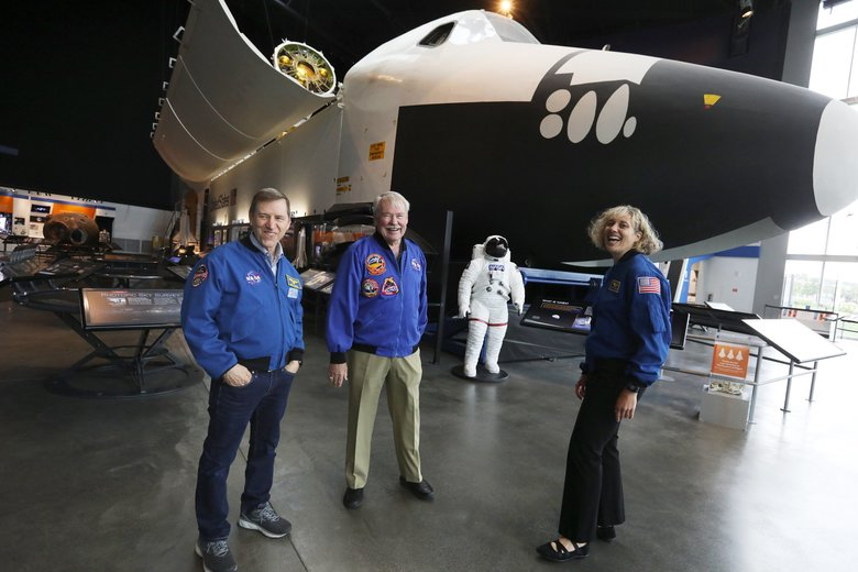 Astronauts Gregory C. Johnson, John Creighton and Dottie Metcalf-Lindenburger are familiar with the NASA space shuttle trainer at Seattle's Museum of Flight. All three used this trainer for their shuttle missions. (Ken Lambert / The Seattle Times)