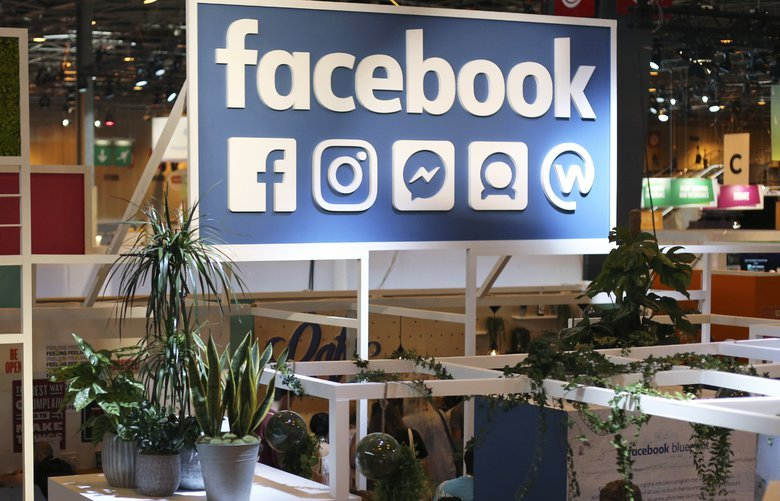 """FILE – In this June 16, 2017 file photo, the Facebook booth is seen at the Vivatech, a gadgets show in Paris, France. France has adopted a pioneering tax on internet giants like Google, Amazon and Facebook despite threats from the U.S. Just ahead of the vote Thursday, French economy minister Bruno Le Maire said allies needed to settle differences """"without using threats."""" (AP Photo/Thibault Camus, File) PAR103 PAR103"""