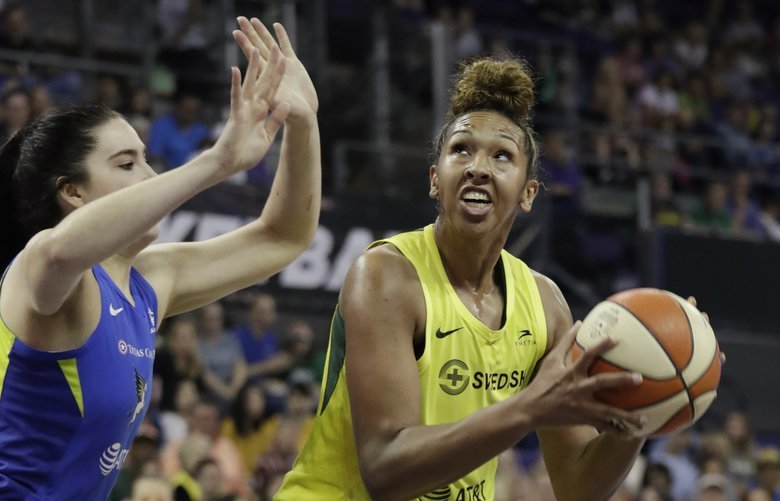 Seattle Storm's Mercedes Russell turns to shoot against the Dallas Wings during the first half of a WNBA basketball game Friday, July 12, 2019, in Seattle. (AP Photo/Elaine Thompson) WAET110 WAET110