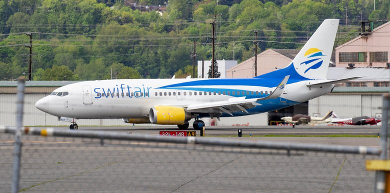 A flight chartered by Immigration and Customs Enforcement to Seattle from Phoenix lands at Boeing Field in April. ICE started operating flights out of the Yakima airport on May 7, after King County prohibited ICE-chartered flights out of Boeing Field. (Mike Siegel / The Seattle Times, file)