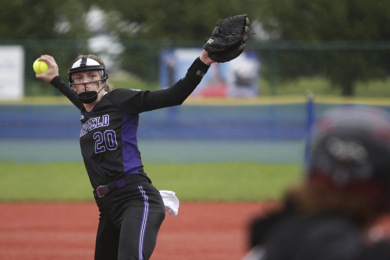 Garfield starting pitcher Kaia Simpson throws in the second inning of the Class 3A state softball title game against Yelm at the Regional Athletic Complex in Lacey on May 25. Garfield defeated Yelm 10-4 to win the state title.  (Jason Redmond / Special to The Seattle Times)