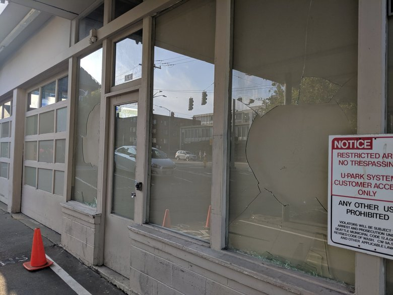 Two broken windows at an abandoned building near the site of Sunday's shooting. (Crystal Paul / The Seattle Times / )