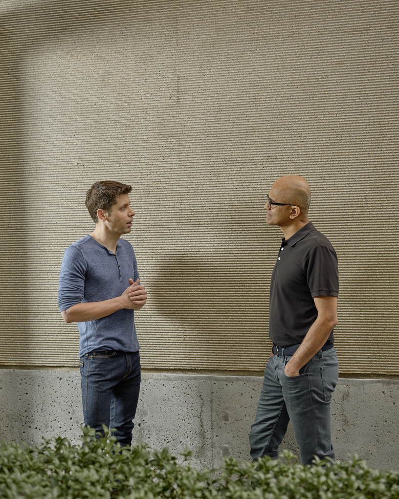 Sam Altman, left, who manages the company OpenAI, and Satya Nadella, the chief executive of Microsoft, which is investing $1 billion in OpenAI, at the Microsoft Campus in Redmond on July 15. Altman's 100-employee company wants to create a machine that can do anything the human brain can do. Skeptics wonder if it is possible. (Ian C. Bates / The New York Times)