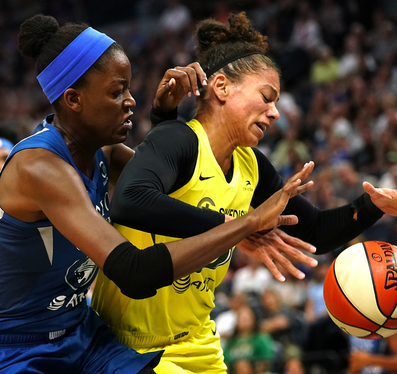 Minnesota Lynx center Temi Fagbenle, left,  and  Storm forward Alysha Clark (32) battle for a rebound Wednesday night in Minneapolis in Seattle's 90-79 victory. (Leila Navidi / Star Tribune)