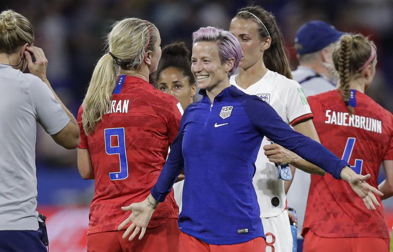 United States' Megan Rapinoe prepares to hug United States goalkeeper Alyssa Naeher after the Women's World Cup semifinal soccer match between England and the United States, at the Stade de Lyon, outside Lyon, France, Tuesday, July 2, 2019. (AP Photo/Alessandra Tarantino) XVG207 XVG207