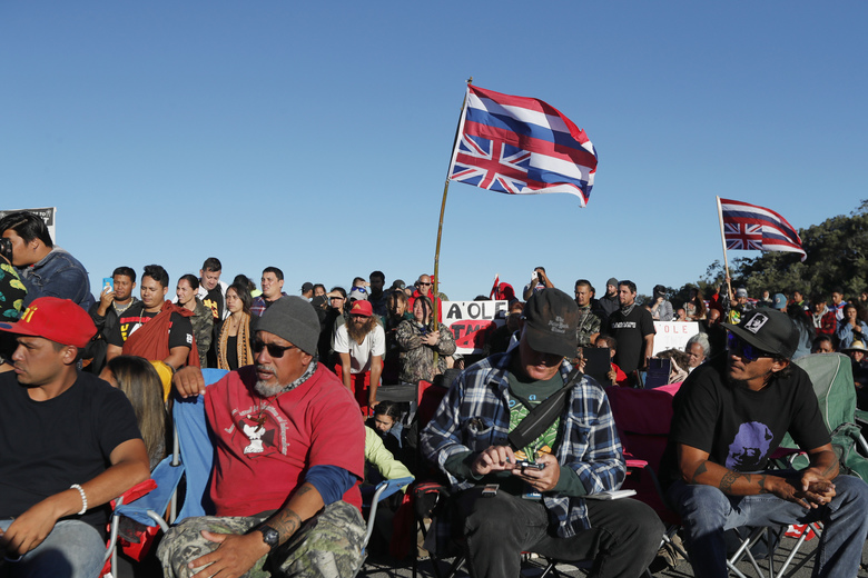 Hundreds of opponents of the TMT listen as Hawaii governor David Ige speaks during a visit to the ninth day of protests against the TMT telescope on Tuesday, July 23, 2019 at the base of Mauna Kea on Hawaii Island. The governor of Hawaii on Tuesday visited protesters blocking the construction of a giant telescope on the state's tallest mountain while acknowledging that their grievances were not just about a new observatory but also about the treatment of Native Hawaiians going back more than a century. (Jamm Aquino/Honolulu Star-Advertiser via AP)