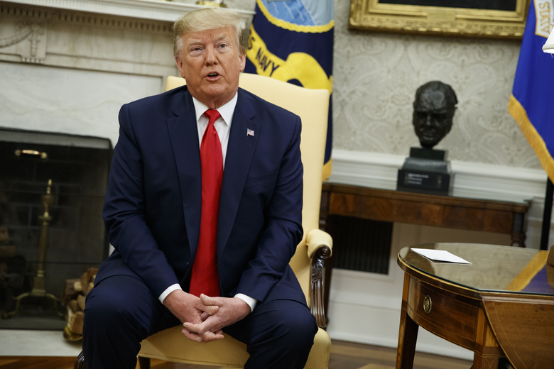 President Donald Trump meets with Qatar's Emir Sheikh Tamim Bin Hamad Al-Thani in the Oval Office of the White House, Tuesday, July 9, 2019, in Washington. (AP Photo/Evan Vucci)