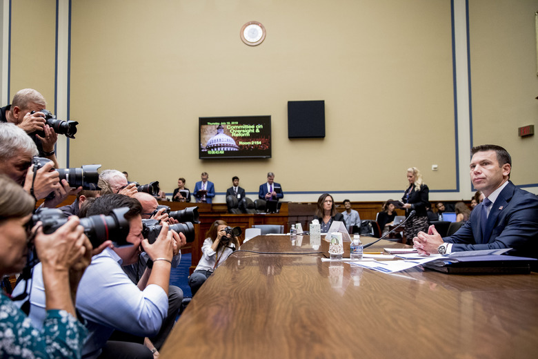 Acting Secretary of Homeland Security Kevin McAleenan arrives to testify before a House Committee on Oversight and Reform hearing on Capitol Hill in Washington, Thursday, July 18, 2019. (AP Photo/Andrew Harnik)