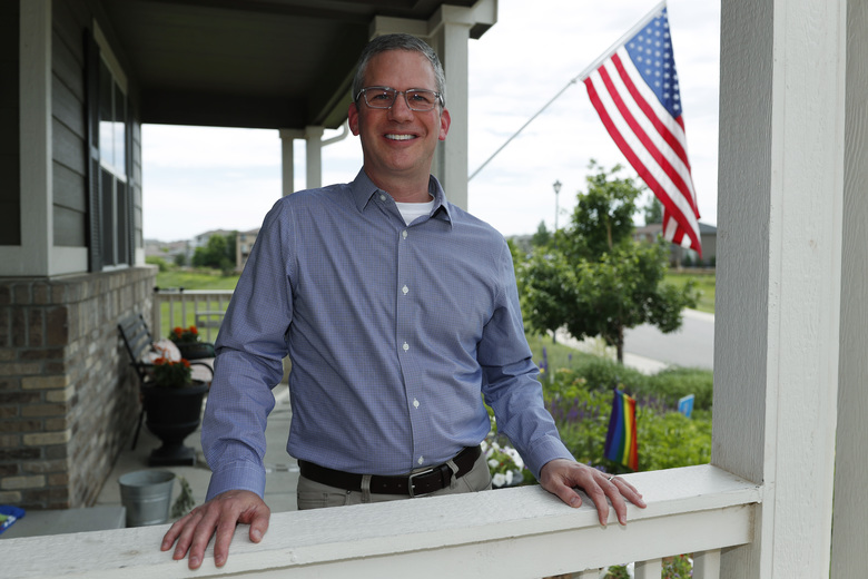 In this Monday, July 1, 2019, photo, software engineer Joe Wilson poses for a photo outside his home in Highlands Ranch, Colo.  The tariffs that the Trump administration has placed on thousands of products imported from China and retaliatory duties placed on U.S. goods are affecting many small businesses, even if they're not importers or exporters. Wilson might have to put off hiring freelancers if he feels the ripple effects of tariffs that his customers must pay. (AP Photo/David Zalubowski)