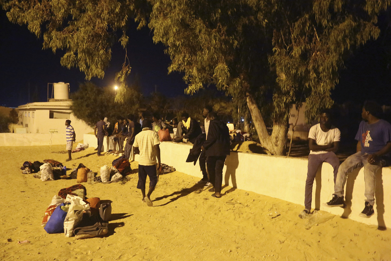 Migrants, who were not affected by an airstrike, take shelter in Tajoura, east of Tripoli Wednesday, July 3, 2019. An airstrike hit a detention center for migrants early Wednesday in the Libyan capital. (AP Photo/Hazem Ahmed)  (AP Photo/Hazem Ahmed)