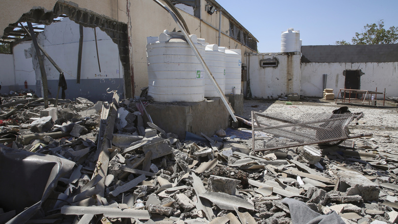 Debris covers the ground after an airstrike at a detention center in Tajoura, east of Tripoli in Libya, Wednesday, July 3, 2019. An airstrike hit the detention center for migrants early Wednesday, killing several.   (AP Photo/Hazem Ahmed)