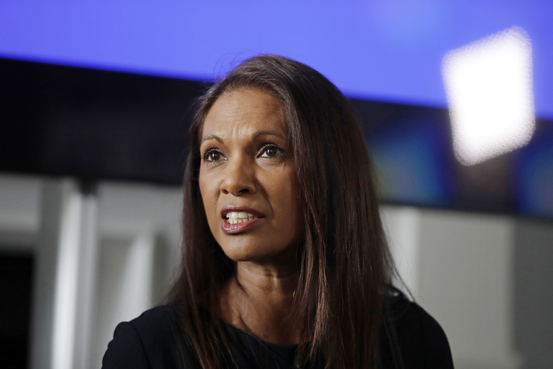 FILE – In this Wednesday, April 26, 2017 file photo, Entrepreneur Gina Miller answers a journalist's question at the Institute of Contemporary Arts in London. An anti-Brexit campaigner who won a major legal case against the British government says she will go to court again if the next prime minister tries to force the country out of the European Union without a deal. Businesswoman Gina Miller says Sunday, July 14, 2019 she has instructed lawyers in anticipation of Boris Johnson winning a Conservative Party leadership contest later this month. (AP Photo/Matt Dunham, file)