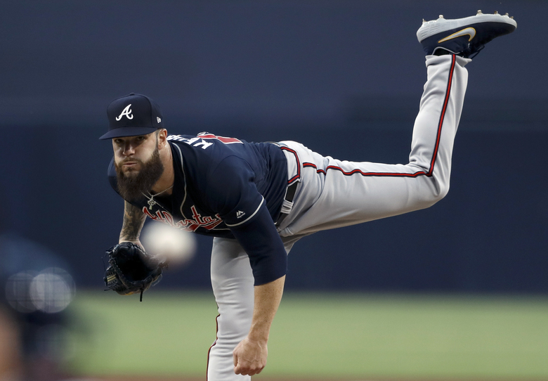 Atlanta Braves starting pitcher Dallas Keuchel works against a San Diego Padres batter during the first inning of a baseball game Friday, July 12, 2019, in San Diego. (AP Photo/Gregory Bull)