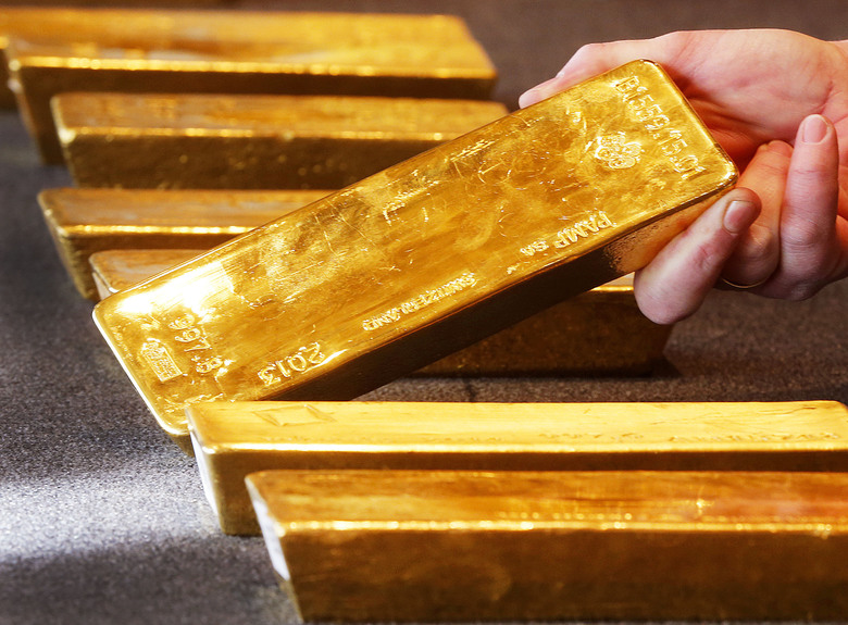 FILE – In this Feb. 9, 2017 file photo various gold bars are on display at the Bundesbank headquarter in Frankfurt, Germany.  (AP Photo/Michael Probst.file)