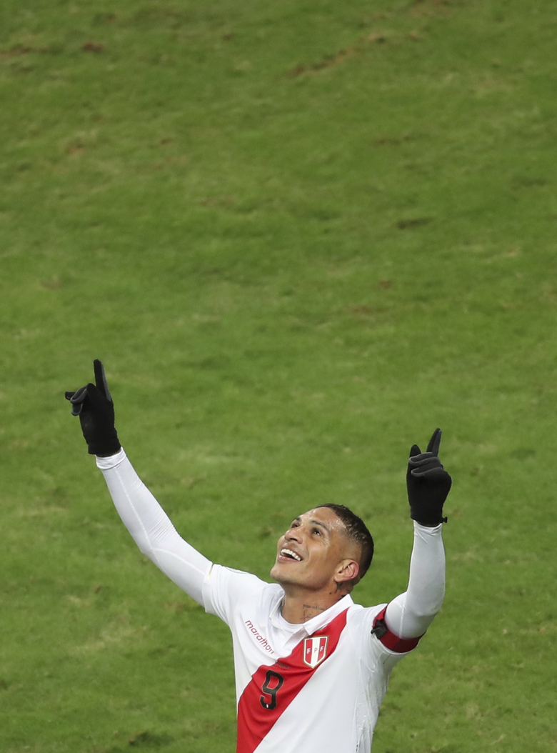 Peru's Paolo Guerrero celebrates scoring his side's third goal against Chile during a Copa America semifinal soccer match at Arena do Gremio in Porto Alegre, Brazil, Wednesday, July 3, 2019. (AP Photo/Edison Vara)