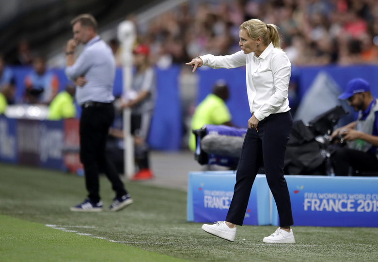 Netherlands coach Sarina Wiegman gestures to her players during the Women's World Cup semifinal soccer match between the Netherlands and Sweden at Stade de Lyon outside Lyon, France, Wednesday, July 3, 2019. (AP Photo/Alessandra Tarantino)