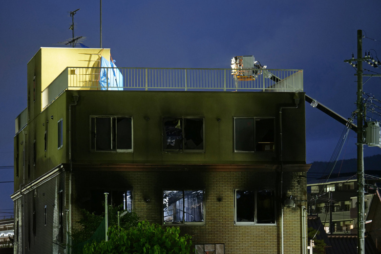 The building of Kyoto Animation is seen following a fire in Kyoto, western Japan, Thursday, July 18, 2019. The fire broke out in the three-story building in Japan's ancient capital of Kyoto, after a suspect sprayed an unidentified liquid to accelerate the blaze, Kyoto prefectural police and fire department officials said.(AP Photo/Hiromi Tanoue)