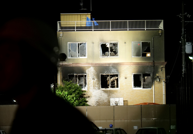 Light is cast on the building of Kyoto Animation following a fire in Kyoto, western Japan, Thursday, July 18, 2019. The fire broke out in the three-story building in Japan's ancient capital of Kyoto, after a suspect sprayed an unidentified liquid to accelerate the blaze, Kyoto prefectural police and fire department officials said.(AP Photo/Hiromi Tanoue)