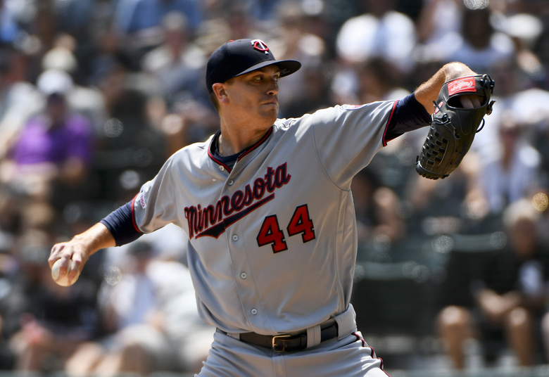 Minnesota Twins starting pitcher Kyle Gibson (44) delivers during the first inning of a baseball game against the Chicago White Sox Sunday July 28, 2019, in Chicago. (AP Photo/Matt Marton)