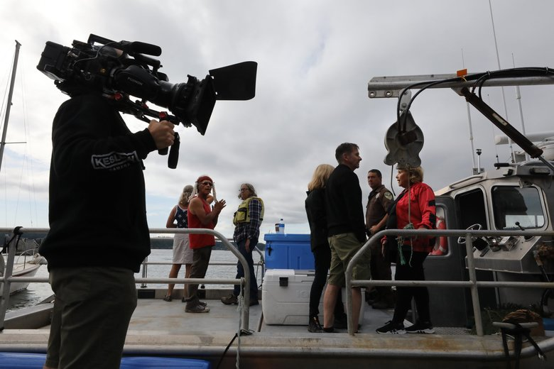 A documentary film crew records during a stop in the San Juan Islands. (Alan Berner / The Seattle Times)
