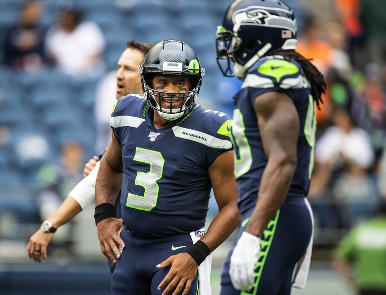 Russell Wilson enjoys warming up before the first preseason game against Denver. The Denver Broncos played the Seattle Seahawks preseason NFL Football Thursday, August 8, 2019 at CenturyLink Field in Seattle, WA. (Dean Rutz / The Seattle Times)