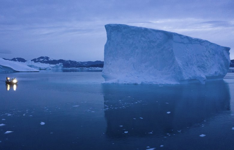 FILE – In this Aug. 15, 2019, file photo, a boat navigates at night next to large icebergs in eastern Greenland. As warmer temperatures cause the ice to retreat the Arctic region is taking on new geopolitical and economic importance, and not just the United States hopes to stake a claim, with Russia, China and others all wanting in. (AP Photo/Felipe Dana, File) XFD305 XFD305