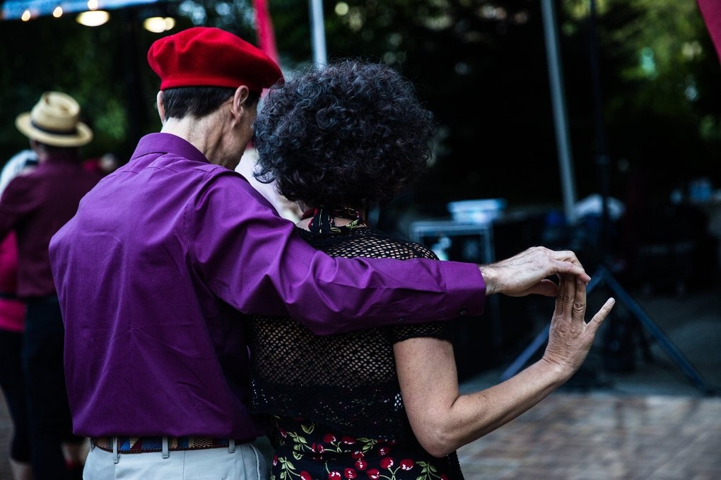 Couples practice a dance move during Dancing til Dusk on Thursday. (Rebekah Welch / The Seattle Times)