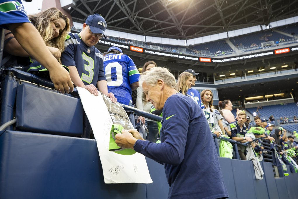 Seahawks head coach Pete Carroll signs autographs before the Seattle Seahawks take on the Oakland Raiders at CenturyLink Field in Seattle Thursday August 29, 2019 for their fourth preseason game. (Dean Rutz / The Seattle Times)
