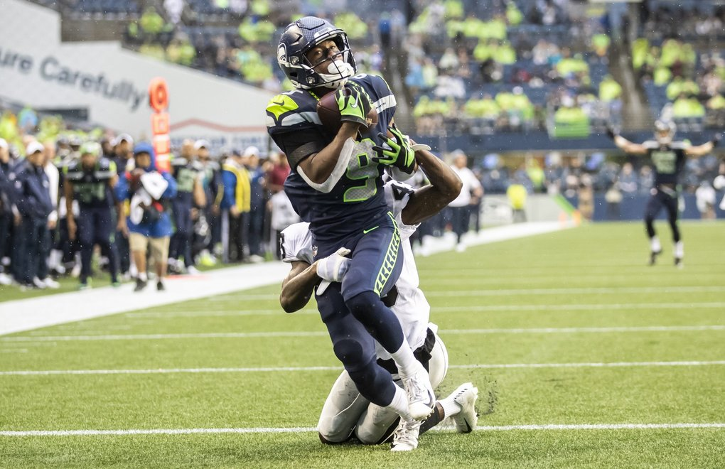 Seahawks wide receiver Terry Wright brings in a 39-yard touchdown from quarterback Geno Smith against Raiders cornerback Makinton Dorleant in the first few minutes as the Seattle Seahawks take on the Oakland Raiders at CenturyLink Field in Seattle Thursday August 29, 2019 for their fourth preseason game. (Dean Rutz / The Seattle Times)