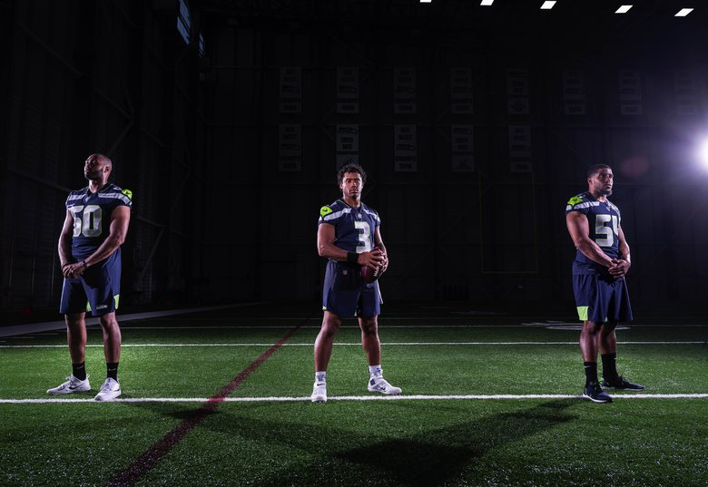 From left, K.J. Wright, Russell Wilson and Bobby Wagner are holdovers from the Seahawks' Super Bowl-winning season.  (Dean Rutz / The Seattle Times)