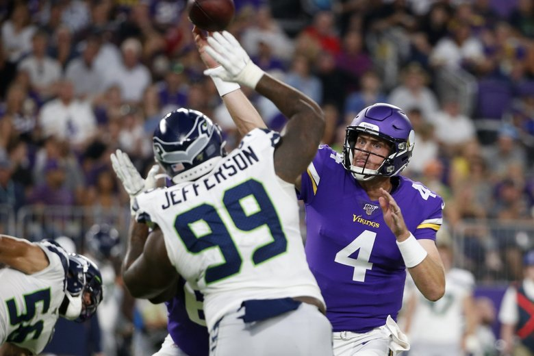 Minnesota Vikings quarterback Sean Mannion (4) throws a pass over Seattle Seahawks defensive tackle Quinton Jefferson (99) during the first half of their preseason game, Sunday, Aug. 18, 2019, in Minneapolis. (Bruce Kluckhohn / The Associated Press)