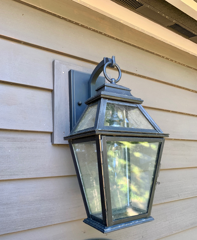 An outdoor fixture helps welcome guests.